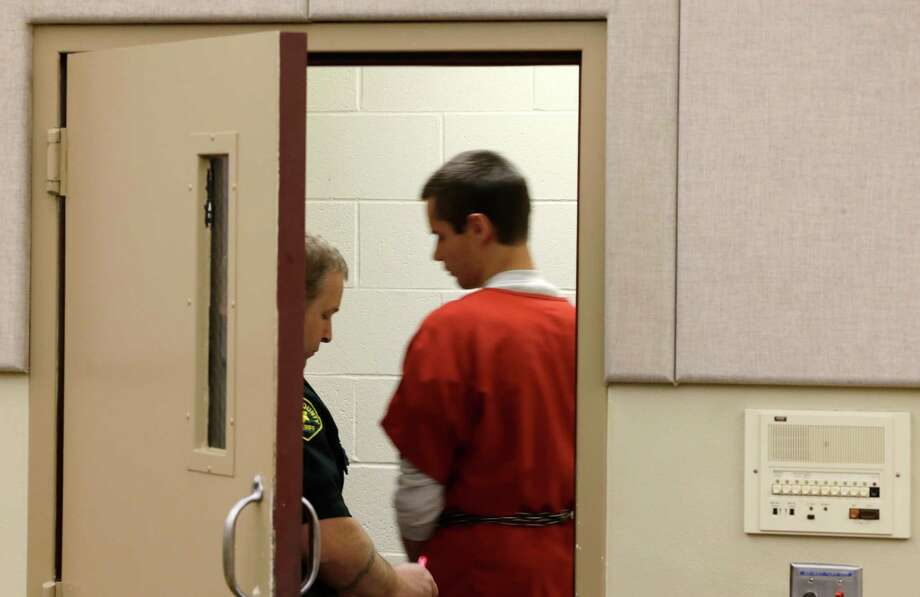 "Colton Harris-Moore, right, who is also known as the ""Barefoot Bandit,"" is led away from a court hearing, Thursday, March 21, 2013, in Mount Vernon, Wash. Harris-Moore is already serving a seven-year prison term after pleading guilty to state and federal crimes, but Skagit County Prosecutor Rich Weyrich filed theft and burglary charges earlier in 2013 against Harris-Moore, accusing him of stealing an airplane from Anacortes, Wash. and flying it to the airport on Orcas Island, Wash. Photo: AP"