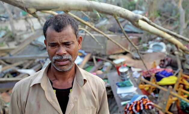 A Bangladeshi man reacts as he inspects his damaged home after a tornado struck the area in Brahmanbaria district, Bangladesh, Saturday, March 23, 2013. The tornado ripped through 20 villages in eastern Bangladesh, killing almost two dozens of people, with another 200 hurt, a government official said Saturday. Photo: AP