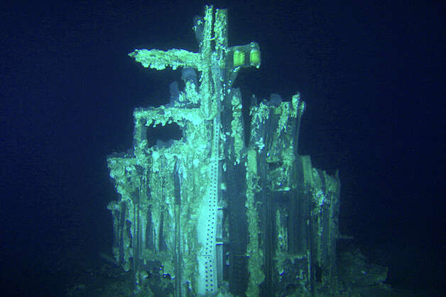 This image provided by Bezos Expeditions shows growths on a Saturn V rocket stage structure on the bottom of the Atlantic Ocean in March 2013. An expedition led by Amazon CEO Jeff Bezos pulled up two rocket engines that helped boost Apollo astronauts to the moon. Bezos and NASA announced the recovery on Wednesday, March 19, 2013. The sunken engines were part of the Saturn V rocket used to bring astronauts to the moon during the 1960s and 1970s. After liftoff, they fell into the ocean as planned. Photo: AP