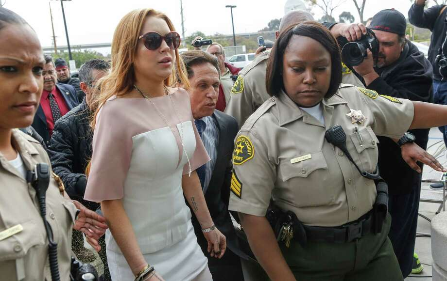 Actress Lindsay Lohan arrives at the Los Angeles Superior court Monday, March 18, 2013. Lohan is charged with three misdemeanor counts stemming from a crash on Pacific Coast Highway. She is charged with willfully resisting, obstructing or delaying an officer, providing false information to an officer and reckless driving. She is also accused of violating her probation in a misdemeanor jewelry theft case. Photo: AP