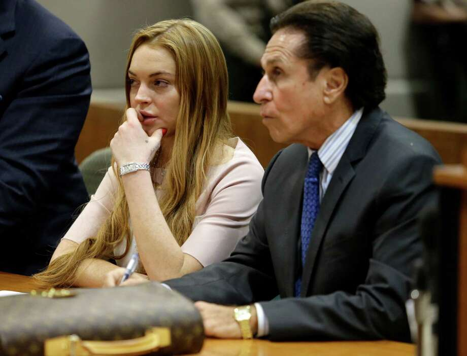 Actress Lindsay Lohan and her attorney Mark Heller listen during a hearing in Los Angeles Superior Court, Monday, March 18, 2013. Lohan accepted a plea deal on Monday in a misdemeanor car crash case that includes 90 days in a rehabilitation facility. The actress, who has struggled for years with legal problems, pleaded no contest to reckless driving, lying to police and obstructing officers who were investigating the accident involving the actress in June. Photo: AP