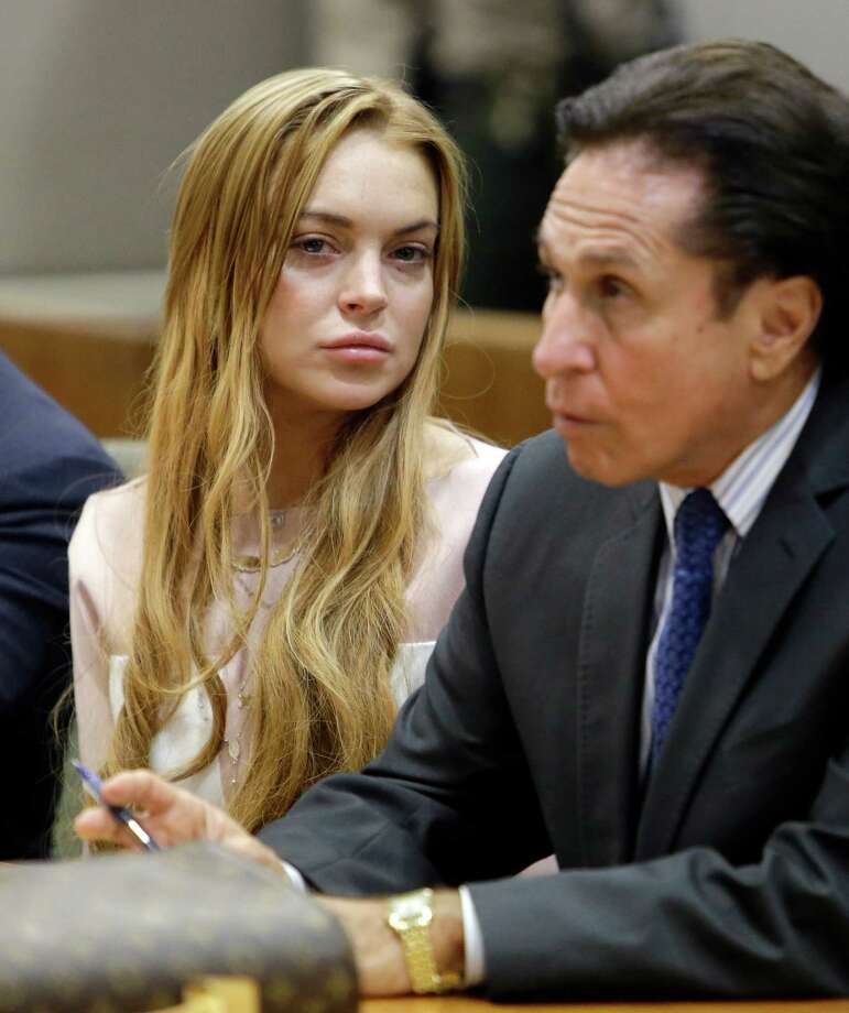 Actress Lindsay Lohan, left, and her attorney Mark Heller appear at a hearing in Los Angeles Superior Court Monday, March 18, 2013. Lohan accepted a plea deal on Monday in a misdemeanor car crash case that includes 90 days in a rehabilitation facility. The actress, who has struggled for years with legal problems, pleaded no contest to reckless driving, lying to police and obstructing officers who were investigating the accident involving the actress in June. Photo: AP