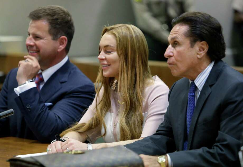 Actress Lindsay Lohan, and attorneys Mark Heller, right, and Anthony Falangetti appear at a hearing in Los Angeles Superior Court Monday, March 18, 2013. Lohan accepted a plea deal on Monday in a misdemeanor car crash case that includes 90 days in a rehabilitation facility. The actress, who has struggled for years with legal problems, pleaded no contest to reckless driving, lying to police and obstructing officers who were investigating the accident involving the actress in June. Photo: AP