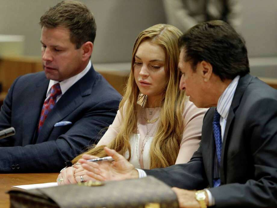 Actress Lindsay Lohan, attorney Mark Heller, attorney Anthony Falengetti, left, at a hearing in Los Angeles Superior Court Monday, March 18, 2013. Photo: AP