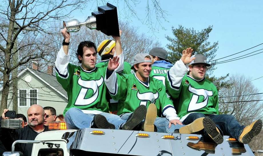 Matt Caranci holds the trophy as the Whalers ride high in Danbury's St. Patrick's Day Parade and Danbury Whalers Commissioner's Cup victory celebration Sunday, March 24, 2013 in Conn. Photo: Michael Duffy / The News-Times