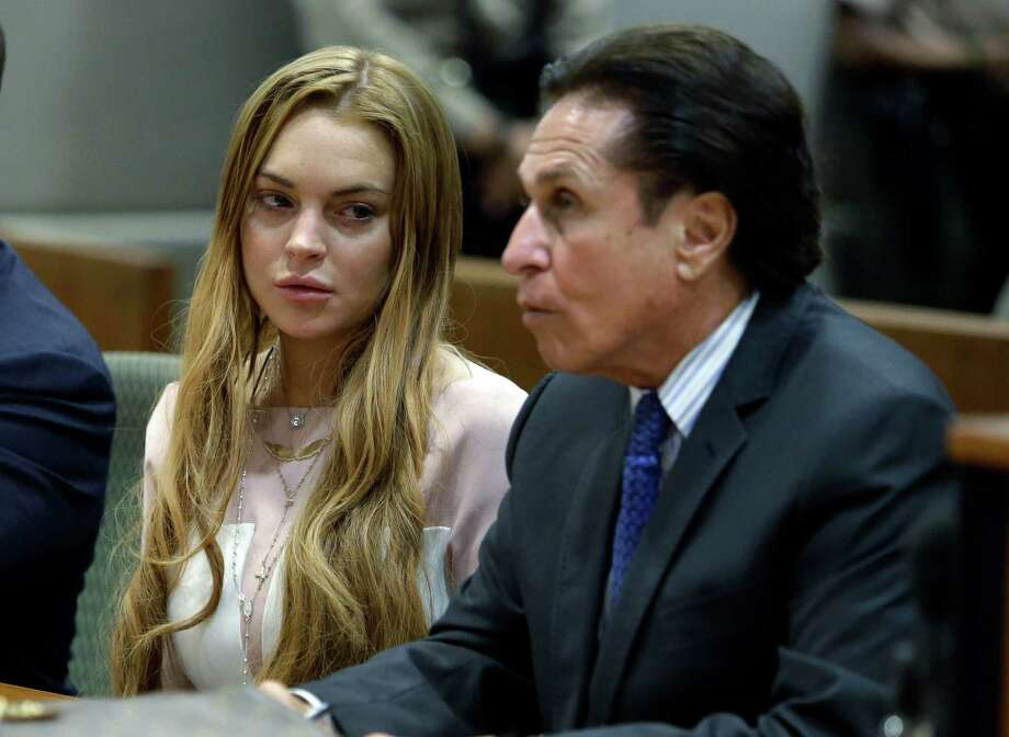 Actress Lindsay Lohan, attorney Mark Heller, at a hearing in Los Angeles Superior Court Monday, March 18, 2013. Photo: AP