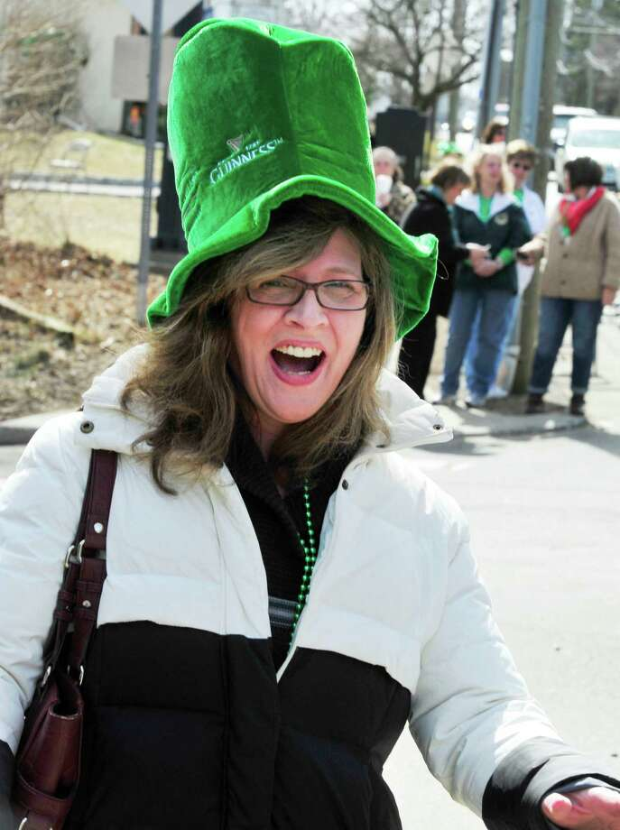 Diane Foster watches Danbury's St. Patrick's Day Parade and Danbury Whalers Commissioner's Cup victory celebration Sunday, March 24, 2013 in Conn. Photo: Michael Duffy / The News-Times