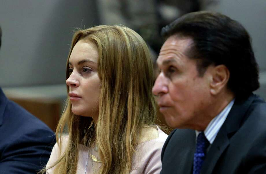 Actress Lindsay Lohan, attorney Mark Heller at a hearing in Los Angeles Superior Court Monday, March 18, 2013. Photo: AP