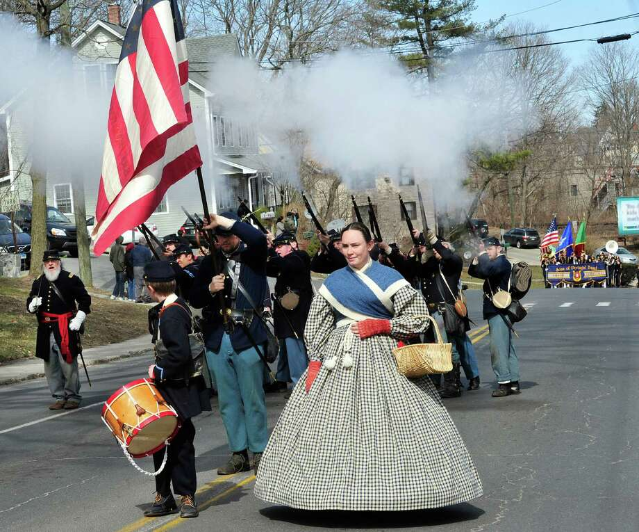 The 11th Regiment Connecticut Volunteer Infantry Co. A fires a volly during Danbury's St. Patrick's Day Parade and Danbury Whalers Commissioner's Cup victory celebration Sunday, March 24, 2013 in Conn. Photo: Michael Duffy / The News-Times