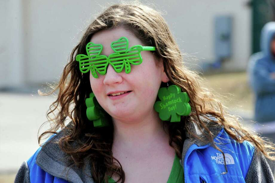 Caila McCaghey watches Danbury's St. Patrick's Day Parade and Danbury Whalers Commissioner's Cup victory celebration Sunday, March 24, 2013 in Conn. Photo: Michael Duffy / The News-Times