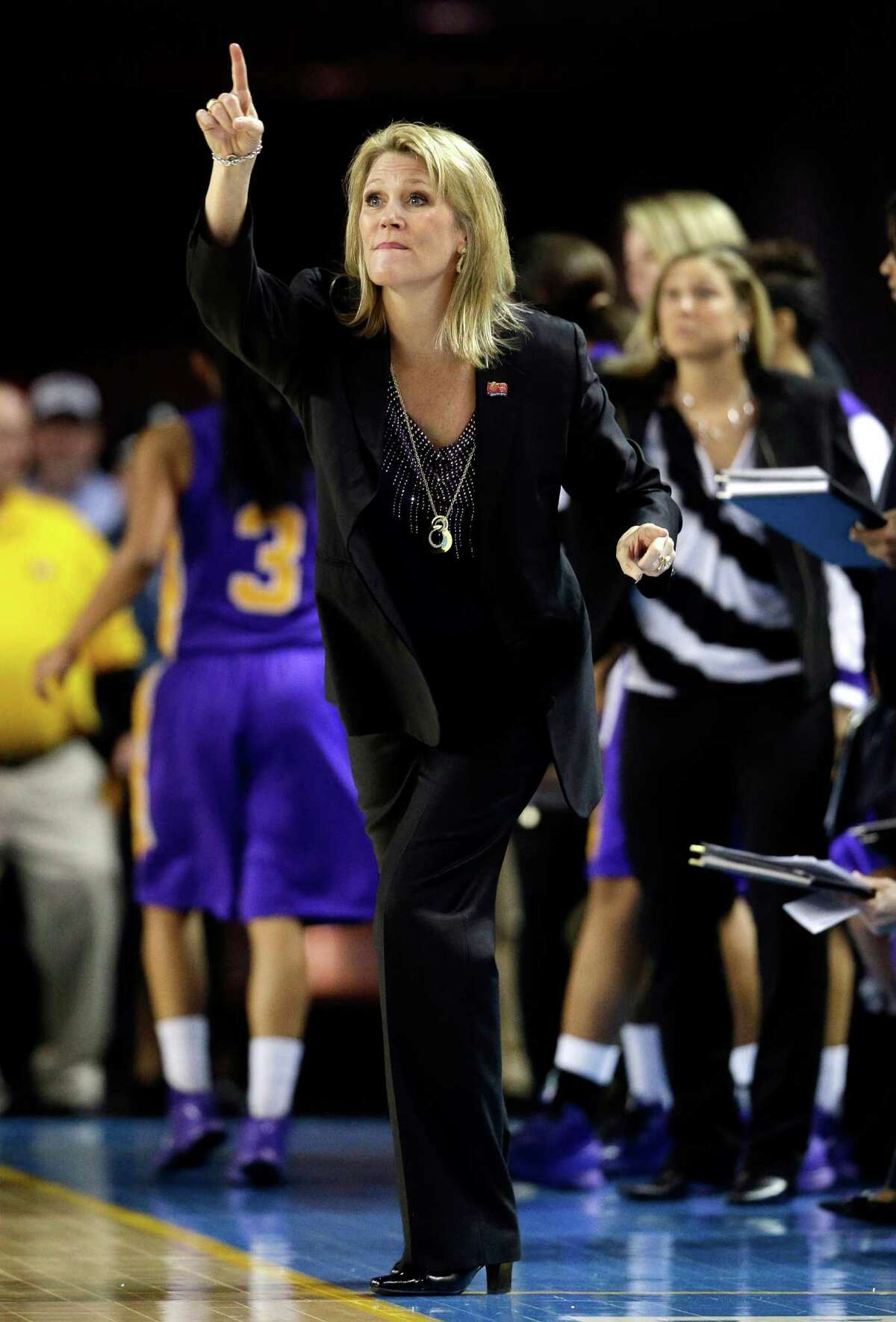 Albany head coach Katie Abrahamson-Henderson directs her players during the first half of a first-round game against North Carolina in the women's NCAA college basketball tournament in Newark, Del., Sunday, March 24, 2013. (AP Photo/Patrick Semansky)