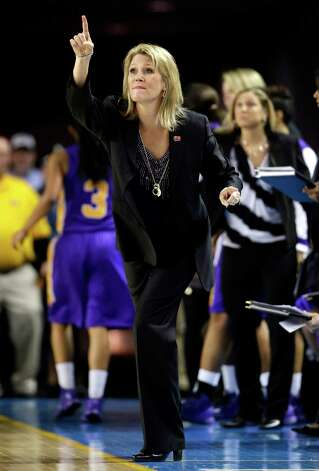 Albany head coach Katie Abrahamson-Henderson directs her players during the first half of a first-round game against North Carolina in the women's NCAA college basketball tournament in Newark, Del., Sunday, March 24, 2013. (AP Photo/Patrick Semansky) Photo: Patrick Semansky / AP