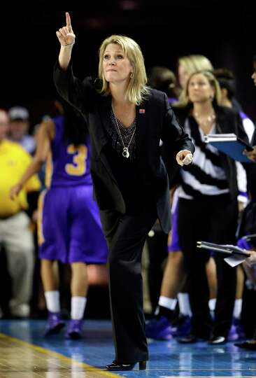 Albany head coach Katie Abrahamson-Henderson directs her players during the first half of a first-ro