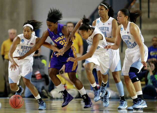 Albany forward Shereesha Richards, second from left, tries to get a loose ball as she is guarded by North Carolina guards, from left to right, Danielle Butts, N'Dea Bryant, Erika Johnson and guard/forward Krista Gross during the first half of a first-round game in the women's NCAA college basketball tournament in Newark, Del., Sunday, March 24, 2013. (AP Photo/Patrick Semansky) Photo: Patrick Semansky / AP