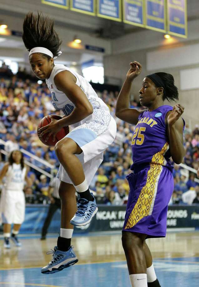 North Carolina guard Danielle Butts, left, grabs a rebound over Albany forward Shereesha Richards during the first half of a first-round game in the women's NCAA college basketball tournament in Newark, Del., Sunday, March 24, 2013. (AP Photo/Patrick Semansky) Photo: Patrick Semansky / AP
