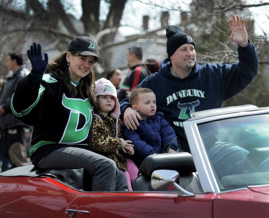Herm Sorcher, CEO and managing partner of the Danbury Whalers, right, rides in a victory parade Sunday, march 24, 2013, down Main Street in Danbury, Conn. With him from left are, Tricia Coe, director of fund raising for the team and Sorcher's children, Samantha, 4, and Max, 3. Photo: Carol Kaliff / The News-Times