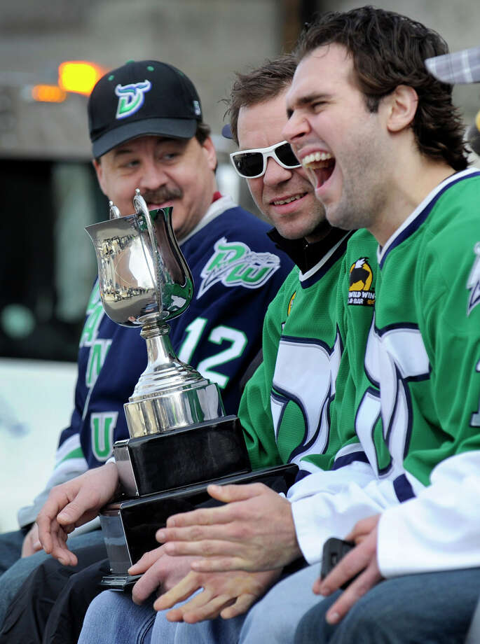 The Danbury Whalers celebrated their championship Commissioner's Cup win Friday night with a parade down Main Street in Danbury, Conn. Sunday, March 24, 2013. From left are, Russ Cole, Lynn Beedle and Matt Caranci. Photo: Carol Kaliff / The News-Times