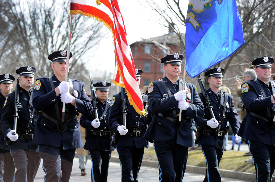 Members of the Danbury Police Department march Sunday, March 24, 2013,  in the St. Patrick's Day Parade and Whalers Commissioner's Cup victory celebration in Danbury, Conn. Photo: Carol Kaliff / The News-Times
