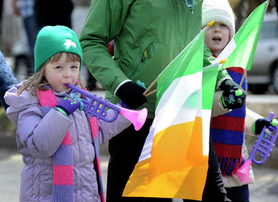 Marchers make their way down Main Street Sunday, March 24, 2013,  in the St. Patrick's Day Parade and Whalers Commissioner's Cup victory celebration in Danbury, Conn. Photo: Carol Kaliff / The News-Times