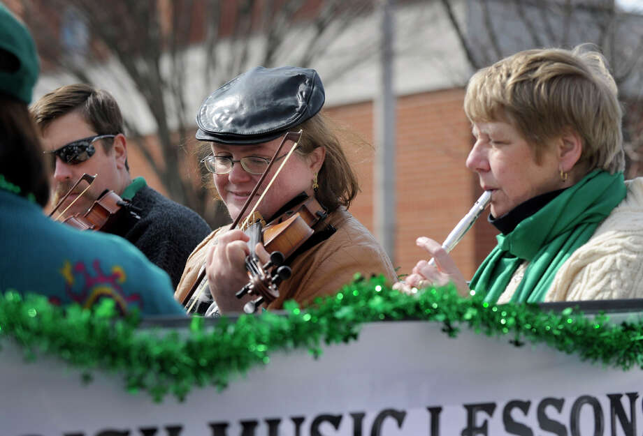 "Musicians on a float with a sign that reads ""Traditional Irish Music Lesson,"" play their instruments in St. Patrick's Day Parade and Whalers Commissioner's Cup victory celebration in Danbury, Conn. Sunday, March 24, 2013. Photo: Carol Kaliff / The News-Times"