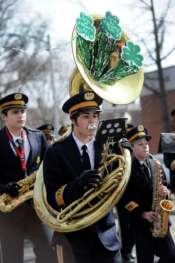 The Sons of Portugal Band marches in the St. Patrick's Day Parade and Whalers Commissioner's Cup victory celebration down Main Street in Danbury, Conn., Sunday, March 24, 2013. Photo: Carol Kaliff / The News-Times