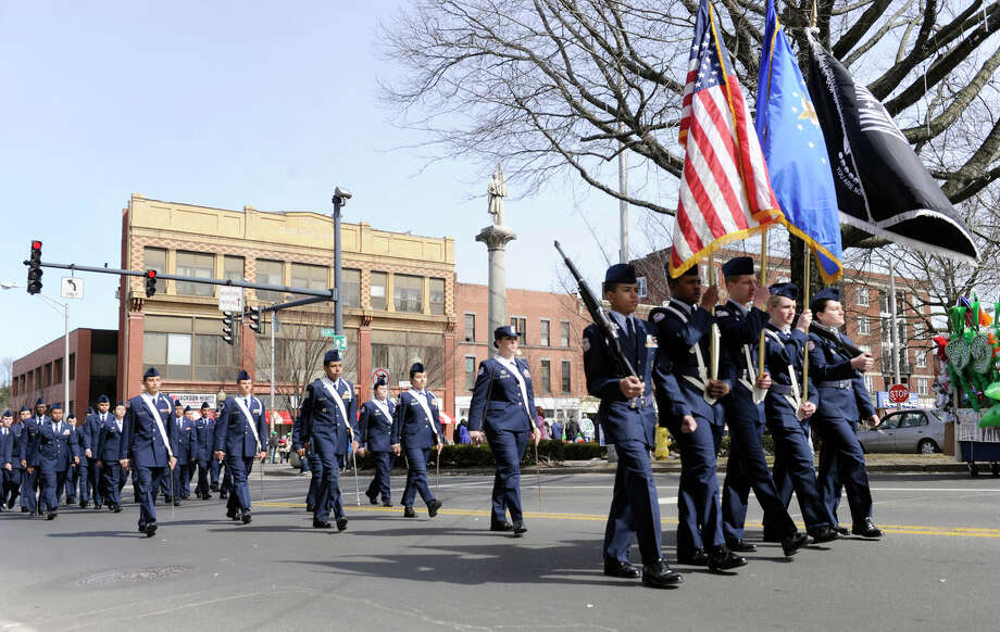 The Danbury High School Junior ROTC turns from Main Street onto West Street as they march in the St. Patrick's Day Parade and Whalers Commissioner's Cup victory celebration in Danbury, Conn., Sunday, March 24, 2013. Photo: Carol Kaliff / The News-Times