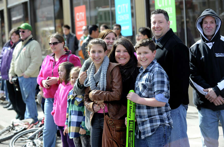 Onlookers watch the St. Patrick's Day Parade and Whalers Commissioner's Cup victory celebration From the corner of Main and West Streets in Danbury, Conn., Sunday, March 24, 2013. Photo: Carol Kaliff / The News-Times