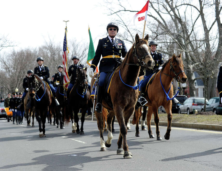 The Governor's Horse Guard marches in the St. Patrick's Day Parade and Whalers Commissioner's Cup victory celebration on Main Street in Danbury, Conn., Sunday, March 24, 2013. Photo: Carol Kaliff / The News-Times