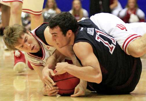 Indiana guard Jordan Hulls, left, and Temple guard T.J. DiLeo (11) become entangled while chasing a loose ball in the second half of a third-round game of the NCAA college basketball tournament on Sunday, March 24, 2013, in Dayton, Ohio. Indiana won 58-52. (AP Photo/Skip Peterson) Photo: Skip Peterson, Associated Press / FR23879 AP