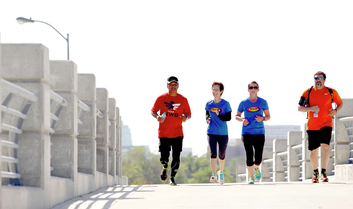 From left to right Alain Ducante, Patti Glinski, Becky Smith and Bill Alllen, run down North MacGregor in Houston, Texas. Alain Ducante ran the entire 200 miles of the Texas Independence Relays starting in Gonzales, Texas at 3 am and finished at the San Jacinto Monument.