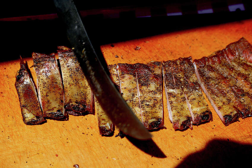 Ribs are prepared at Pizzitola's BBQ-Ribs tent at the BBQ fest at 9401 Knight Road in Houston.