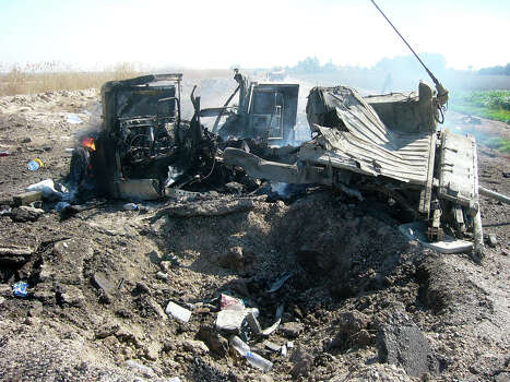 Sgt. Shilo Harris was in the front seat of this Humvee, which was hit by a powerful roadside bomb south of Baghdad on Feb. 19, 2007. His team was in search of an IED but didn't realize they had been lured into an insurgent ambush. Photo: Courtesy/