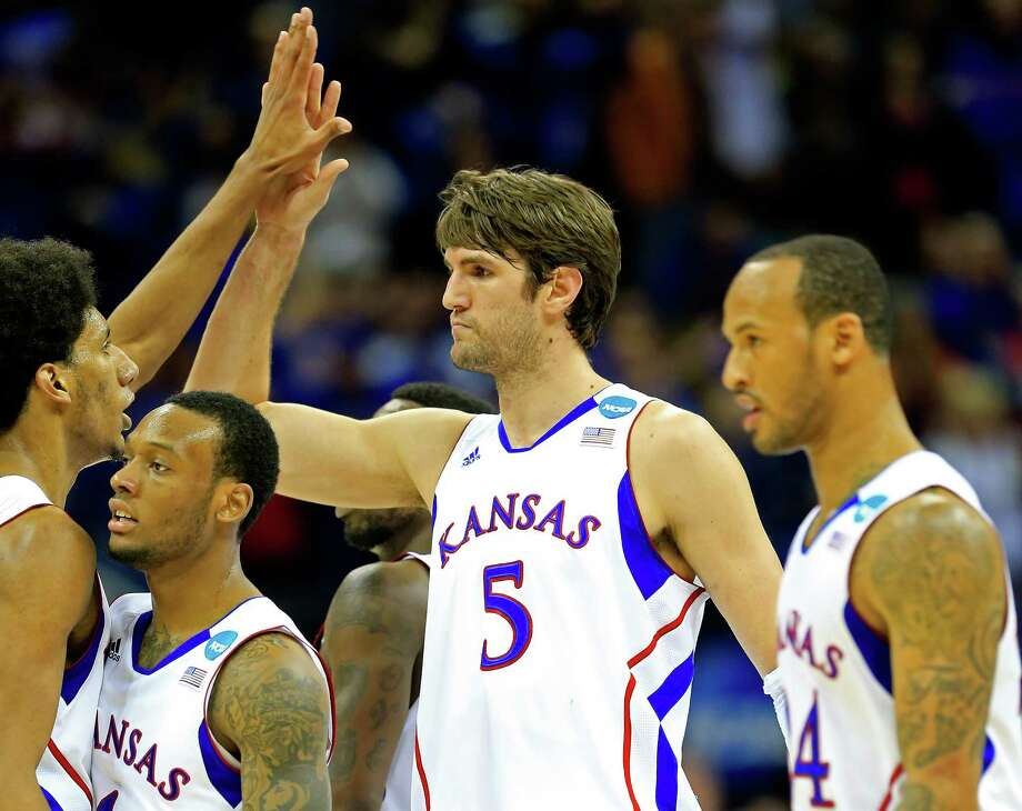 Kansas 70, North Carolina 58KANSAS CITY, MO - MARCH 24:  Jeff Withey #5 of the Kansas Jayhawks celebrates with teammates against the North Carolina Tar Heels during the third round of the 2013 NCAA Men's Basketball Tournament at Sprint Center on March 24, 2013 in Kansas City, Missouri. Photo: Jamie Squire, Getty Images / 2013 Getty Images