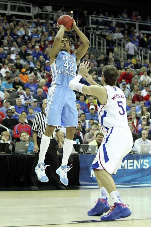 KANSAS CITY, MO - MARCH 24:  James Michael McAdoo #43 of the North Carolina Tar Heels attempts a shot in the second half against Jeff Withey #5 of the Kansas Jayhawks during the third round of the 2013 NCAA Men's Basketball Tournament at Sprint Center on March 24, 2013 in Kansas City, Missouri. Photo: Ed Zurga, Getty Images / 2013 Getty Images