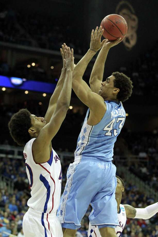 KANSAS CITY, MO - MARCH 24:  James Michael McAdoo #43 of the North Carolina Tar Heels attempts a shot in the second half against Kevin Young #40 of the Kansas Jayhawks during the third round of the 2013 NCAA Men's Basketball Tournament at Sprint Center on March 24, 2013 in Kansas City, Missouri. Photo: Ed Zurga, Getty Images / 2013 Getty Images