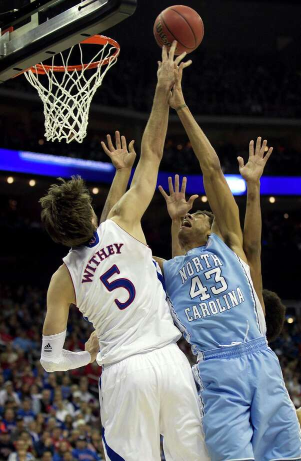 Kansas' Jeff Withey (5) blocks a shot by North Carolina's James Michael McAdoo (43) during the first half of a third-round game in the NCAA Tournament at the Sprint Center in Kansas City, Missouri, Sunday, March 24, 2013. (Robert Willett/Raleigh News & Observer/MCT) Photo: Robert Willett, McClatchy-Tribune News Service / Raleigh News & Observer