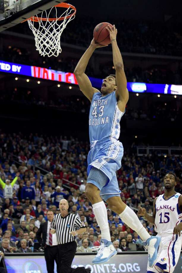 North Carolina's James Michael McAdoo (43) drives to the basket for a dunk past Kansas' Elijah Johnson (15) in the first half of a third-round game in the NCAA Tournament at the Sprint Center in Kansas City, Missouri, Sunday, March 24, 2013. (Robert Willett/Raleigh News & Observer/MCT) Photo: Robert Willett, McClatchy-Tribune News Service / Raleigh News & Observer