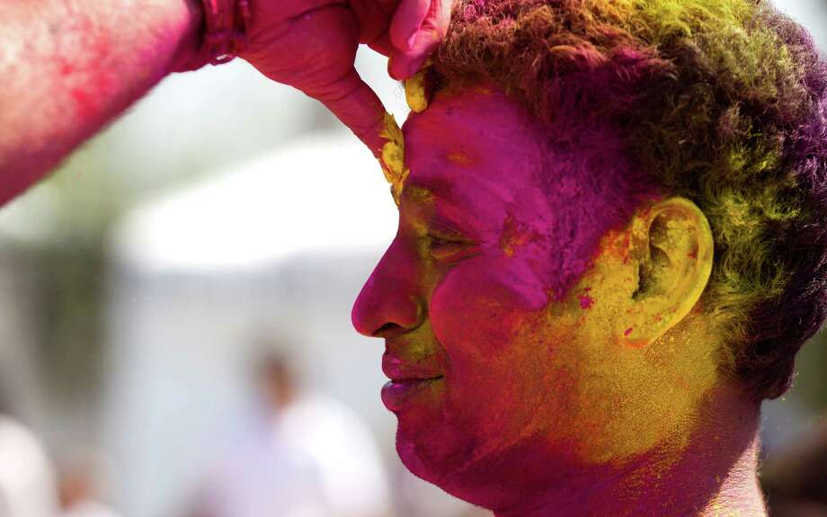 A reveler has color applied to his face to celebrate Holi at Seabourne Creek Park Sunday, March 24, 2013, in Rosenberg. Photo: Brett Coomer, Houston Chronicle / © 2013 Houston Chronicle