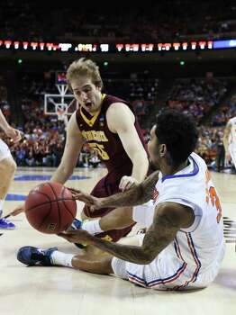 AUSTIN, TX - MARCH 24:  Mike Rosario #3 of the Florida Gators and Elliott Eliason #55 of the Minnesota Golden Gophers vie for posession in the first half during the third round of the 2013 NCAA Men's Basketball Tournament at The Frank Erwin Center on March 24, 2013 in Austin, Texas. Photo: Stephen Dunn, Getty Images / 2013 Getty Images