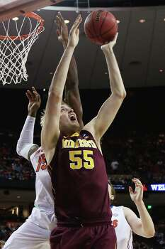 AUSTIN, TX - MARCH 24:  Elliott Eliason #55 of the Minnesota Golden Gophers goes up against Will Yeguete #15 of the Florida Gators in the first half during the third round of the 2013 NCAA Men's Basketball Tournament at The Frank Erwin Center on March 24, 2013 in Austin, Texas. Photo: Stephen Dunn, Getty Images / 2013 Getty Images