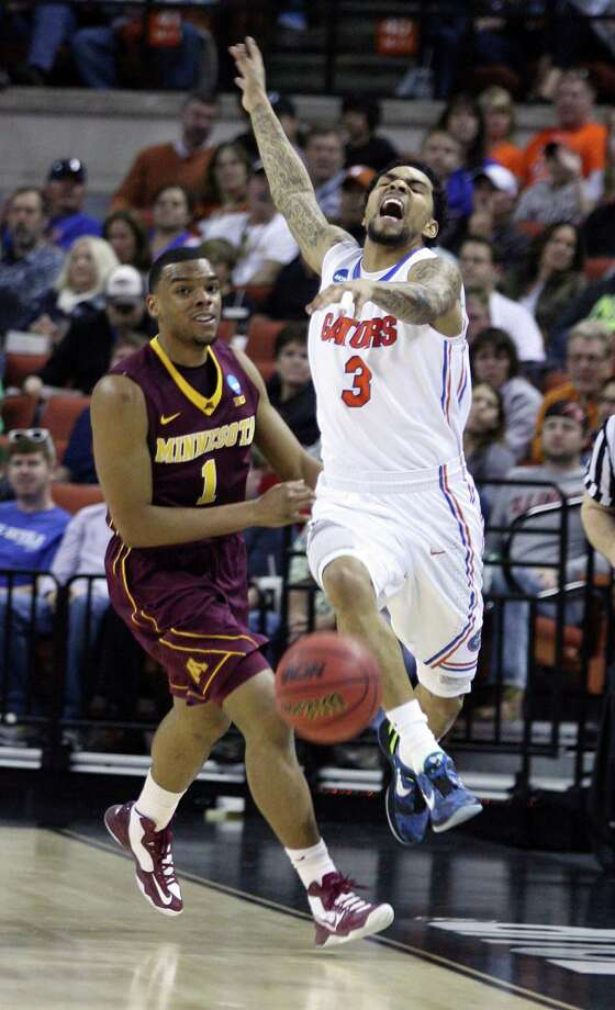 Florida guard Mike Rosario (3) is fouled by Minnesota guard Andre Hollins (1) during the third-round action in the NCAA Tournament at the Frank Erwin Center in Austin, Texas, on Sunday, March 24, 2013. (Stephen M. Dowell/Orlando Sentinel/MCT) Photo: Stephen M. Dowell, McClatchy-Tribune News Service / Orlando Sentinel