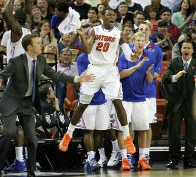 Florida guard Michael Frazier II (20) celebrates on the bench during the third-round action in the NCAA Tournament at the Frank Erwin Center in Austin, Texas, on Sunday, March 24, 2013. (Stephen M. Dowell/Orlando Sentinel/MCT) Photo: Stephen M. Dowell, McClatchy-Tribune News Service / Orlando Sentinel
