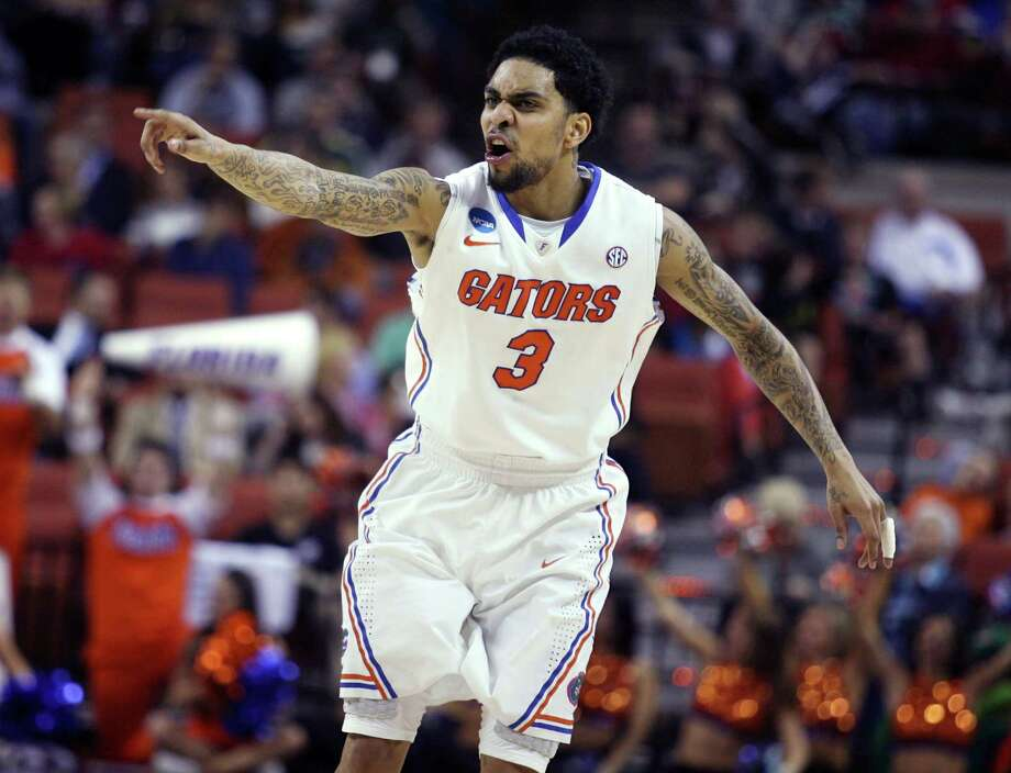 Florida guard Mike Rosario celebrates after scoring against Minnesota during the third-round action in the NCAA Tournament at the Frank Erwin Center in Austin, Texas, on Sunday, March 24, 2013. (Stephen M. Dowell/Orlando Sentinel/MCT) Photo: Stephen M. Dowell, McClatchy-Tribune News Service / Orlando Sentinel