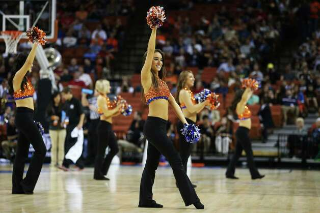 AUSTIN, TX - MARCH 24:  Florida Gators cheerleaders perform in the first half against the Minnesota Golden Gophers during the third round of the 2013 NCAA Men's Basketball Tournament at The Frank Erwin Center on March 24, 2013 in Austin, Texas. Photo: Ronald Martinez, Getty Images / 2013 Getty Images