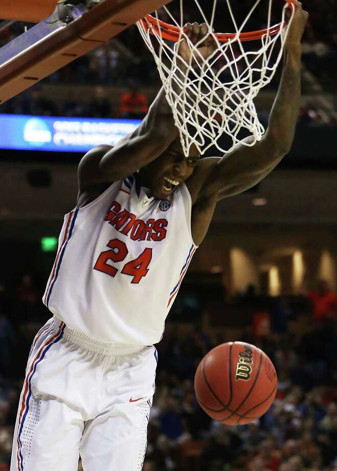 Florida 78, Minnesota 64AUSTIN, TX - MARCH 24:  Casey Prather #24 of the Florida Gators dunks against the Minnesota Golden Gophers during the third round of the 2013 NCAA Men's Basketball Tournament at The Frank Erwin Center on March 24, 2013 in Austin, Texas. Photo: Ronald Martinez, Getty Images / 2013 Getty Images