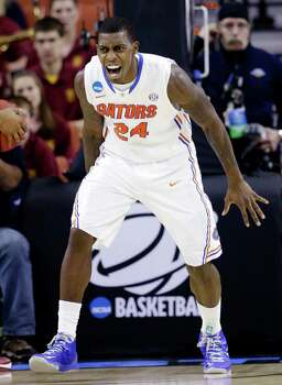 Florida's Casey Prather reacts after scoring against Minnesota during the first half of a third-round game of the NCAA college basketball tournament, Sunday, March 24, 2013, in Austin, Texas. (AP Photo/David J. Phillip) Photo: David J. Phillip, Associated Press / AP
