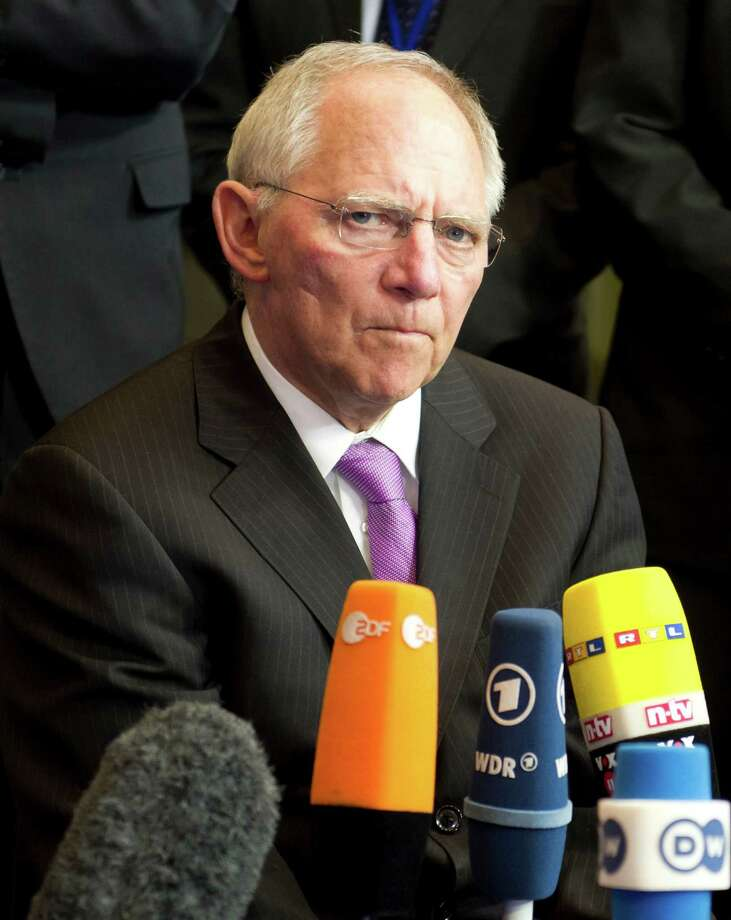 German Finance Minister Wolfgang Schaeuble speaks with the media during an emergency eurogroup meeting in Brussels on Sunday, March 24, 2013. The EU says a top official will chair a high-level meeting on Cyprus in a last-ditch effort to seal a deal before finance ministers decide whether the island nation gets a 10 billion euro bailout loan to save it from bankruptcy. (AP Photo/Geert Vanden Wijngaert) Photo: Geert Vanden Wijngaert, STR / AP