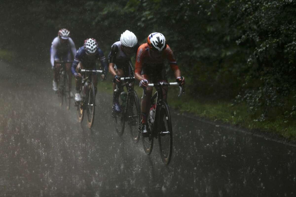 You bike like a Seattleite if you... Think rain like this is no big deal.