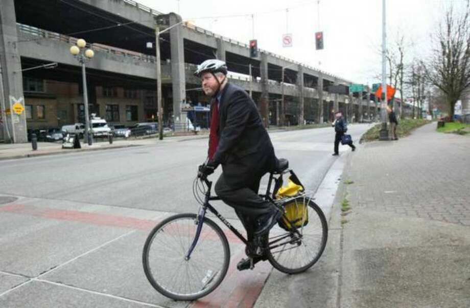 Are sometimes called ''Mayor McSchwinn.'' (Seattle Mayor Mike McGinn biking away from a news conference). Photo: Joshua Trujillo / seattlepi.com