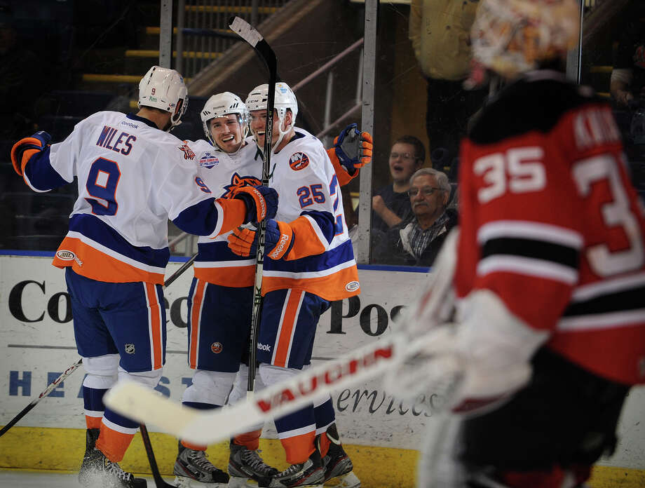 From left; Sound Tigers Sean Wiles, Mike Halmo, and Jordan Hill celebrate Hill's second goal of the game during the second period of their matchup with the Albany Devils at the Webster Bank Arena in Bridgeport, Conn. on Sunday, March 24, 2013. Photo: Brian A. Pounds / Connecticut Post